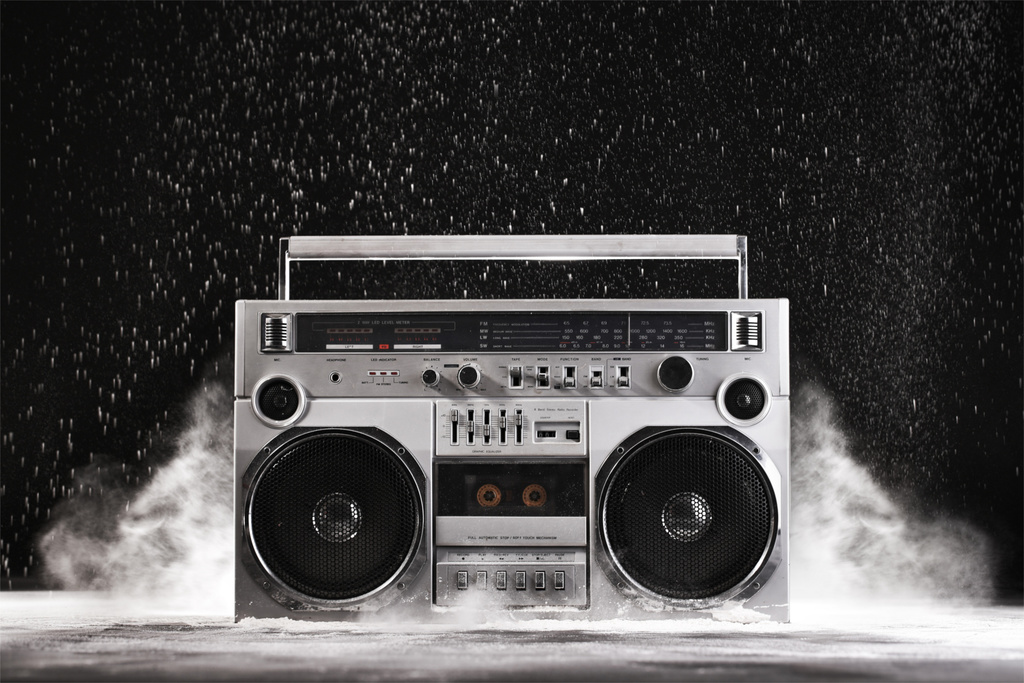 1980s Silver Retro ghetto blaster and dust isolated on black background with clipping path