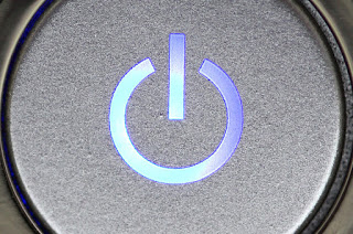power button on the side of a computer pv
