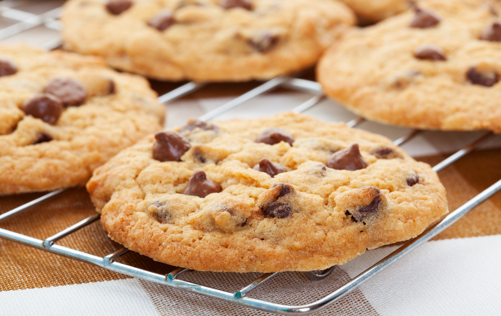 Chocolate chip cookies on a rack.