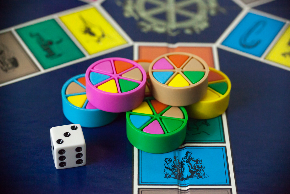 Trivia Pursuit game board and pieces.